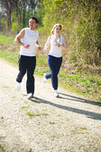 Couple jogging in the nature — Stock Photo