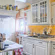 图库照片: White Kitchen in Country Style