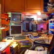 Foto Stock: Chaotic Technological Private Working Place