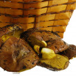 Freshly collected wild mushrooms and basket — Stock Photo #8735608