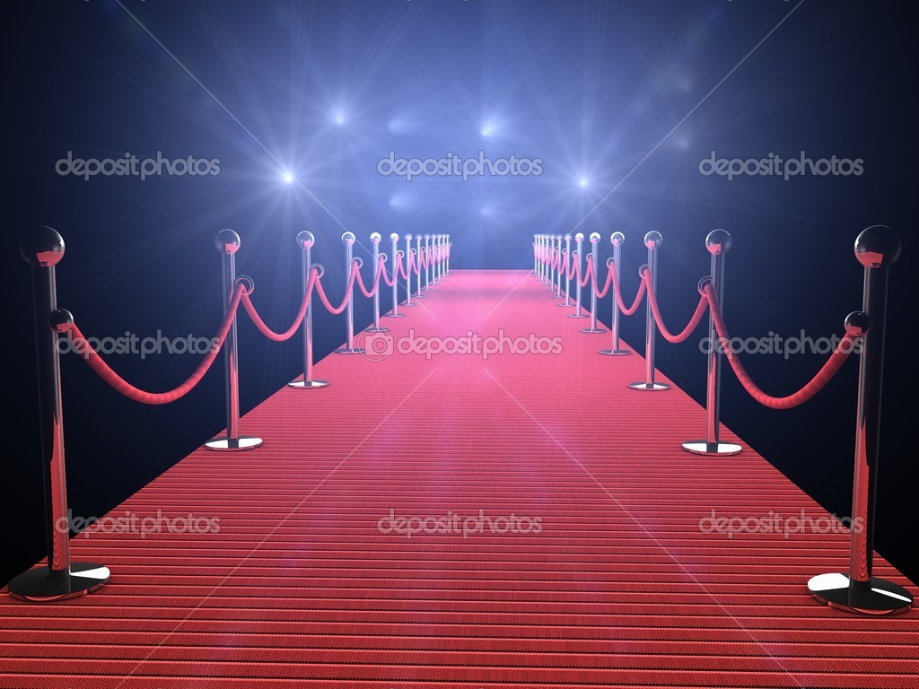 Red carpet with flash lights in the background — Stock Photo #8314205
