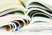 Heap of open magazines — Stock Photo