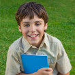 Stock Photo: Happy school boy with note book