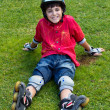 Happy boy in roller blades — Stock Photo
