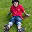 Happy boy in roller blades — Stock Photo
