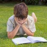 Boy reading book — Stock Photo