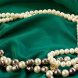 Silk with pearls — Stock Photo