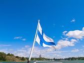 Finnish flag over harbor at Naantali, Finland — Stock Photo