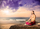 Yoga meditation near the ocean — Stock Photo