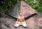 Yoga meditation on the roof — Stock Photo