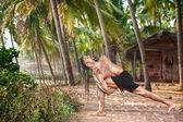 Yoga twisting pose — Stock Photo