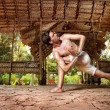 Yoga in Indian shala - Stock Photo