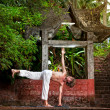 Yoga near temple — Stock Photo #10565685