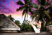 Yoga on the roof in India — Stock Photo