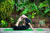 Yoga in the garden — Stock Photo