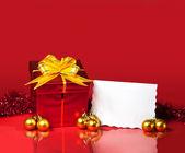 Christmas gift and blank card — Stock Photo