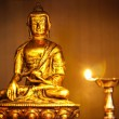 Golden Buddha with oil lamp - Foto de Stock