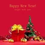 Christmas tree and present — Stock Photo