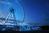 Observation wheel and rollercoaster — Stock Photo