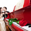Royalty-Free Stock Photo: Red rose on piano
