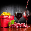 Wine and red present — Stock Photo