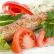 Grilled meat with fresh vegetables and herbs — Stock Photo
