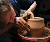 Potter, creating an earthen jar on the circle — Stock Photo