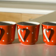Red Mugs with a heart — Stockfoto
