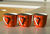 Red Mugs with a heart — Stok fotoğraf