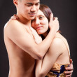 Young happy pregnant couple in love closeup on black background in studio — Stock Photo #8951199