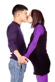 Young happy pregnant couple in love closeup on black background in studio — Stock Photo