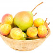 Pears and apricots in fruit basket isolated on white background - Zdjęcie stockowe