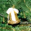 Stock Photo: Gold Christmas bell and green spruce branch