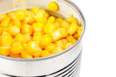 Opening can with corn isolated on the white — Stock Photo