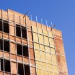 Royalty-Free Stock Photo: Office building construction site. Thermal insulation  of walls