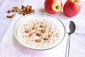 Kasha with milk and nuts — Stock Photo