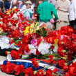 Flowers near the monument on victory day - Stock Photo