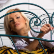 Portrait of young girl on the bed — Stock Photo