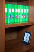 Books and modern ereader — Foto de Stock