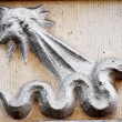 Old vintage bas-relief with snake — Stock Photo