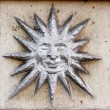 Old vintage bas-relief with sun — Stockfoto