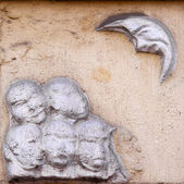 Old vintage bas-relief with moo — Stock fotografie
