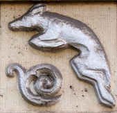 Old vintage bas-relief with wolf — Stock Photo