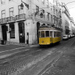 The old yellow  tram in Lissabon - Stock Photo