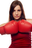 Pretty confident woman with boxing gloves — Stock Photo