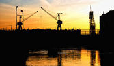 Silhouettes of portal cranes — Stock Photo