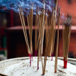 Burning incense sticks - Stock Photo