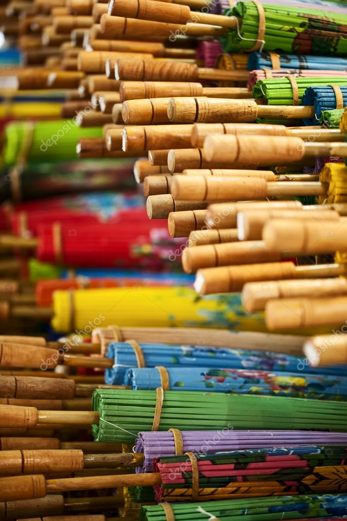 Wooden rice paper colorful umbrellas — Stock Photo #9099688