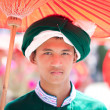 CHIANG MAI, THAILAND - FEBRUARY 4: Traditionally dressed man por - Zdjęcie stockowe