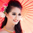 CHIANG MAI, THAILAND - FEBRUARY 4: Traditionally dressed woman i - Stock Photo